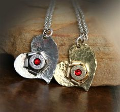 Hand-hammered heart with bullet casing rosette and Swarovski crystal.