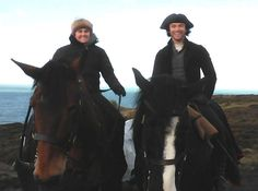 Aidan riding with the woman who cares for the horses on-set.