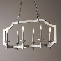 Sleek Pagoda Frame Island Chandelier This intriguing rectangular pagoda like frame design features sleek upscale transitional style. For more modern appeal use our mini tubular bulbs shown