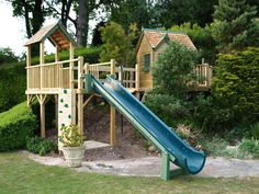great use of a slope - half treehouse half play ground