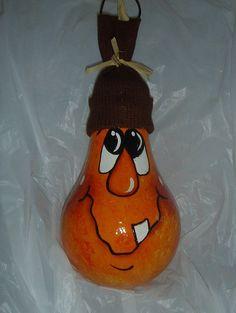 what a cute face for a pumpkin theme light bulb ornament