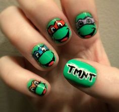 TMNT NAILS! So obviously, you do your toes to look like shells, right, with little turtle tails? (and Michellangelos has an empty corner of a pizza box next to it, right? right?) All hail turtle power.