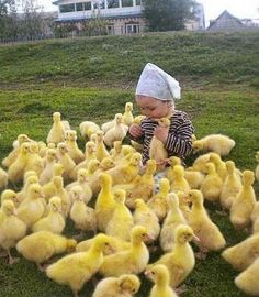 CUTEST LITTLE CHILD AND ITS GATHERING OF ADORABLE LITTLE DUCKS Happiness is...SPRING!