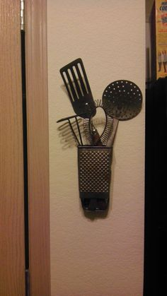 Used old grater to store some of my old utensils