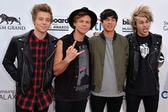 Luke Hemmings, Ashton Irwin, Calum Hood and Michael Clifford of 5 Seconds of Summer attend the 2014 Billboard Music Awards