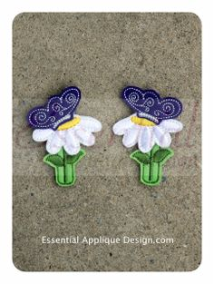 Essential Applique Design - Butterfly on Daisy Clippies, $3.99 (http://www.essentialappliquedesign.com/butterfly-on-daisy-clippies/)