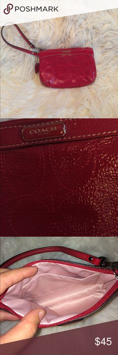 COACH red wristlet Red Coach wristlet with signature C's on it. One slot on the inside. Lightly used! Price is firm. Coach Bags Clutches & Wristlets