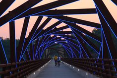 High trestle trail Bridge is one of the most unique biking bridges in Iowa. It is a half a mile long bridge that stands 13 stories high over the Des Moines River Valley. The Bridge is on a 25 mile bike trail and is located between two small towns called Woodward and Madrid. It once was a bridge for a pacific railroad train, but is now a beautiful bike/walking path that attracts many people because of it's unique architecture and view. It also lights up at night too.