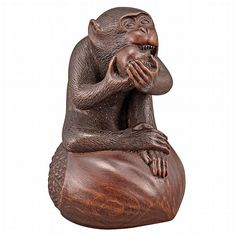 apanese Boxwood Netsuke of a Monkey Signed Masanao, Edo Period, 19th century Modeled seated on a large chestnut, one leg crossed over the other, biting into a fruit held with both hands. Height 2 1/8 inches.