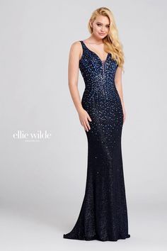 Ellie Wilde EW120100. Sleeveless shimmer jersey sheath gown with a plunging v-neck, natural waist, strappy criss cross back, stone accents throughout gown and a sweep train.