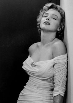 """Marilyn Monroe, 1952: """"I drove to the outskirts of Los Angeles, where she lived in a two-room apartment. What impressed me in the living room was the obvious striving for self-improvement. I saw a photograph of Eleanora Duse and a multitude of books that I did not expect to find there, like the works of Dostoevsky, Freud, the history of Fabian socialism, etc. On the floor were two barbells."""" - Philippe Halsman"""