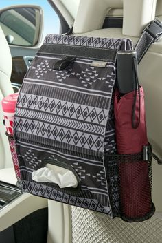 Fully leakproof patterned car trash bag and car seat back organizer has a full sized tissue box holder and two side compartments to keep bottles and containers from tipping or spilling. Durable polyester fabric and fully sealed car trash can. Trash Can For Car, Car Trash, Trash Bag, Storage Boxes, Bag Storage, Craft Storage, Storage Ideas, Car Seat Organizer, Car Organizers