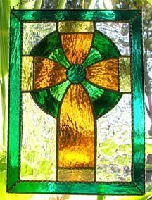 Celtic Cross Stained Glass Suncatcher Panel in Tea . $42.95. Decorative Celtic stained glass cross suncatcher. High quality stained glass is used in the making of this decorative Celtic cross design. The colors can never fade. The sun catcher is finished with decorative solder work that is very seldom seen on most stained glass pieces on the market. An attractive chain is attached to each piece. Due to the size of our suncatchers, they should not be hung w...