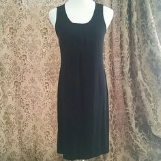 *DROP!* CHICO'S BASIC BLACK DRESS * Simple black shift dress * Pleated detail at bust * Tank style sleeves * Acetate / Spandex blend  * Super comfy yet chic! * Tagged Chico's Sz 1 which will fit a 10. Can fit an 7 or 12 depending on style preference  * Feel free to ask for measurements  * Excellent condition!  Reasonable offers always considered. Over 150 items listed so take a look and bundle to save more! Chico's Dresses