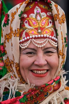 A Russian woman in traditional costume waits for the beginning of the annual Maslentisa parade.