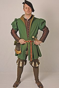 Costume made for a 1530s Groom of the Buckhounds in the household of Henry VIII. Full length slashed cross cut hose, silk camlet doublet and coat of broadcloth. Made to the specifications listed in the wardrobe accounts of 1538/1539. Made for JMD&Co at Hampton Court Palace