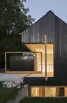 The dark facade that covers Das Schwarze Haus has been preserved through carbonization, instead of through chemical treatment. Buero Wagners design sits quietly in the countryside, a slender volume rising out of the trees. ideas #modernoutdoorspaces #modernarchitecture