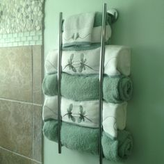 I needed more storage for towels after I renovated my small bathroom. I installed 2 matching towel bars vertically.