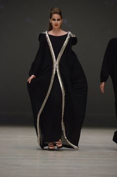 Abaya. It's black but the details are nuveau. Check the shoulder and linked details. LOVE. Abeer Al Suwaidi  of Ush Designs.