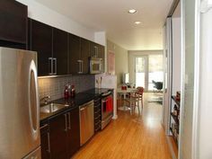 little dividing wall to define kitchen vs. living/eating space