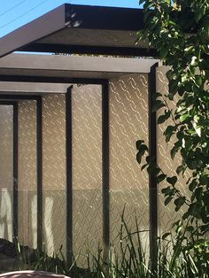 Decorative or privacy screen used to shield a lap pool and patio from sun and eyeballs from beyond  a street wall. This is our 'Eden' design cut in compressed hardwood (Weathertex) in a smooth style and beautifully painted finish. ~QAQ #decorativescreens #privacyscreens #patios #homeimprovement