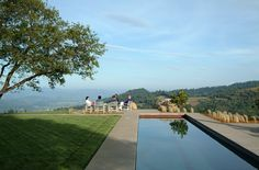Wine & Cheese on top of the world.  Picture from: Charlie Barnett Associates-Napa Residence.  image#1