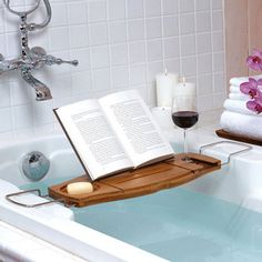 The Ultimate Relaxation - a hot bath, good book, candles and a glass of Merlot <3