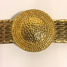 """HP Gold Medallion Metal Stretch Belt  1/30 Total Trendsetter HP by ~ @debbimiller  This belt is proof that good things come in a small package. It features a textured Golden Circle medallion which conceals a hook closure, metal fish scales covered fully elasticized body. This is truly an amazing piece to add to your wardrobe. 1"""" x 25"""" flat, comfortable extends to 34"""" Accessories Belts"""