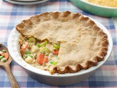 Chickless Pot Pie : Trisha's vegetarian take on chicken pot pie is just as decadent without the meat. Although the luscious vegetable filling with peas, carrots and potatoes could be a meal on its own, wrapping it in premade pie dough seals in flavor with a crispy crust. via Food Network