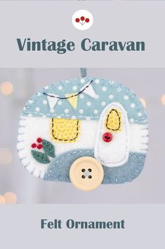 Handmade from felt in soft blue and white with red details, this hanging vintage trailer ornament has a button wheel and door knob, and tiny bunting flags.With blanket stitched edges and a cotton loop for hanging. #feltchristmasornaments #vintagecaravan #feltornaments #vintagetrailer #campinggift Fabric Ornaments, Felt Christmas Ornaments, Scandi Christmas, Bunting Flags, Camping Gifts, Blanket Stitch, Felt Fabric, Handmade Felt, Vintage Caravans