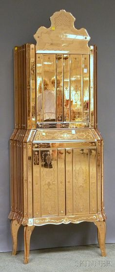 DISCOVERY I SILVER, ESTATE JEWELRY, TEXT - SALE 2551M - LOT 813 - VENETIAN-STYLE ETCHED PEACH MIRRORED GLASS-CLAD FOUR-DOOR BOUDOIR CABINET, IN TWO PARTS, WITH MIRRORED INTERIORS AND CHROME FITTINGS, U - Skinner Inc
