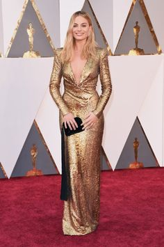 Margot Robbie - Tom Ford gold sequin gown, black tasseled clutch by The Row, and Forevermark diamonds - The 88th Annual Academy Awards