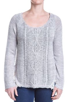 In the event that you find a secret garden of your own, you will be dressed perfectly. This sheer gray sweater with its unfinished edges creates an enchanted feeling every time you put it on, while the ruffled detail in back
