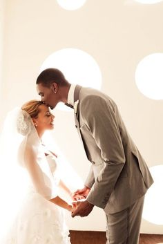 Miami Heat forward Chris Bosh married Adrienne Williams at the Fontainebleau Hotel in Miami on July 16, 2011.  The bride wore Oscar de la Renta strapless wedding dress style 22E32 with crystal detailing along the waist. Oscar de la Renta gowns are sold at The Bridal Salon at Saks Jandel.
