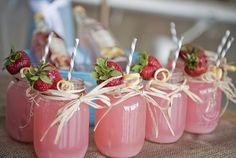 Jam jar cocktails for the big girls and pink lemonade for the little girls .