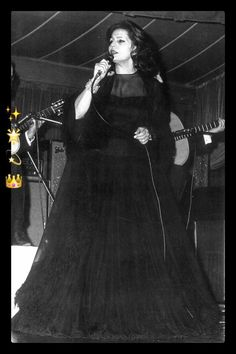 Amalia Rodrigues The Queen Of Fado Portugal Travel, Hui, Portuguese, Divas, Fashion Inspiration, Queen, Lisbon Portugal, Singers, Arches