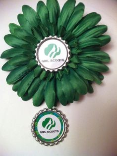 girl scout flower pin or hair bow with flattened bottle cap
