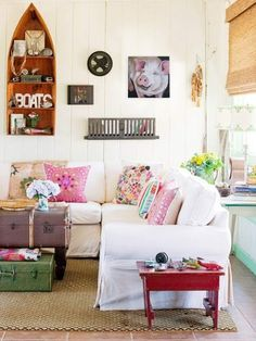 Really love the look of these pillows on the cream, slipcovered sofa.  This is a look I could get in my living room when my paneling is painted white, nice textures, colors and comfy feminine look.     Mod Vintage Life: Paintings