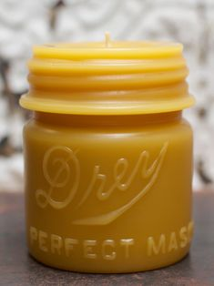 Beeswax Candle  how do you get the candle by itself? break the mason jar's glass once the candle has set?