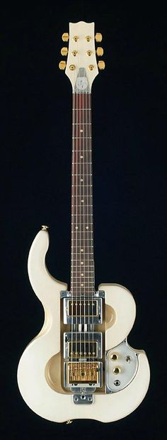 Norton Guitars | white Python electric guitar with huge horn. #Guitars
