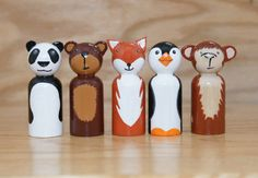 This listing is for 5 wooden animal peg dolls (2.375 tall). There is a panda bear, brown bear, fox, penguin, and monkey. I would love to make a custom listing if there is an animal that youd like me to make that isnt apart of this set. The dolls are painted using acryIic paint and then coated with a gloss varnish to protect the finish. The ears are glued on very well but are still delicate. Not meant for children under three years old. This set comes in a drawstring bag for easy travel…