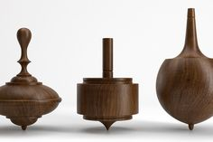 """These spinning tops were made by Klein Reid for Herman Miller , they chose Eames' enormous toy collection as inspiration. """"Toys are not re. Lathe Projects, Wood Turning Projects, Wood Projects, Hanukkah Diy, Spinning Top, Toy Art, Wooden Tops, Wood Lathe, Made Of Wood"""