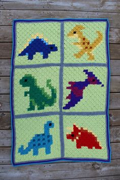 For Christmas this year, I wanted to make a new blanket for each of the boys that was inspired by something they both loved. As you can see from this blanket, my little guy is really into dinosaur…