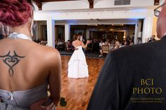 Bridal party members watch the the bride and grooms first dance following their wedding ceremony at Harbour Ridge Yacht and Country Club in Pt St Lucie Florida.