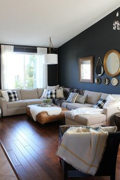Reasons to Choose a Sectional Sofa – Honey n Hydrangea. I love the dark navy almost black wall!!!