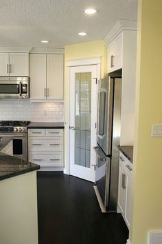 I like the white cabinets with the black floor