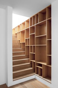 gorgeous wooden bookshelves integrated into stairs