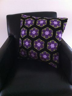 Pillow for outside. Made with crochet African flowers.