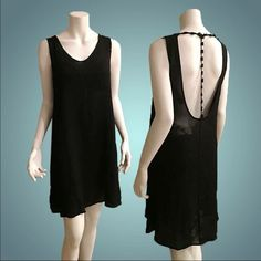 Evangelina T-Back Dress A comfortable, sexy dress with back baring potential is a must for the season ahead. Consider this soft, supple mini your hot-weather pick. Strappy back detail. 100% viscose. Unlined. Made with love in the USA Dresses