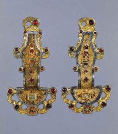 Merovingian looped fibula. Early medieval Europe. Mid-sixth century C.E. Silver gilt worked in filigree, with inlays of garnets and other stones.